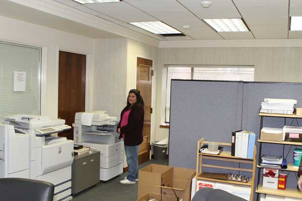 Human Solutions Energy Coordinator Roxanne Beveridge Makes Photocopies In The Main Office Area Now Fully Restored After Being Badly Damaged By Fire